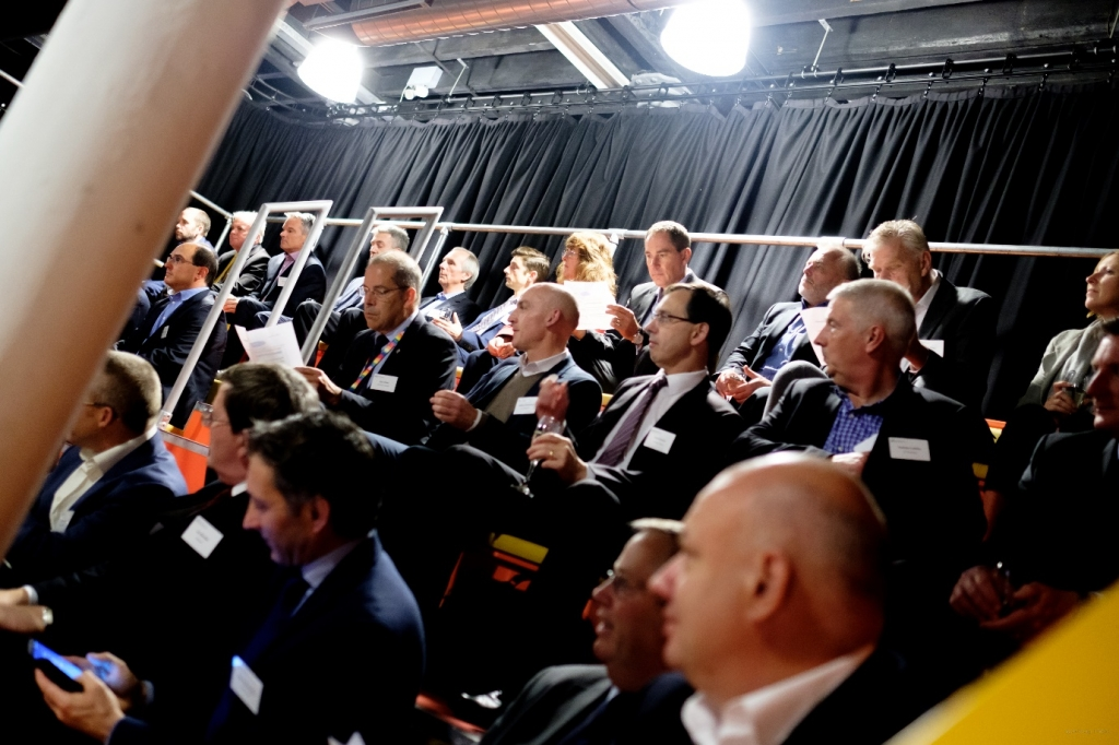 Packed rows of high tech CEOs in the Engine Shed auditorium